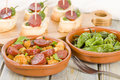 Chorizo bread and padron peppers tapas spanish dishes pinchos with on background Royalty Free Stock Image