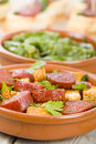 Chorizo bread and padron peppers tapas spanish dishes pinchos with on background Stock Photography