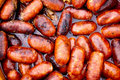 Chorizo red sausages fried in oil Royalty Free Stock Photo