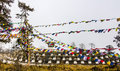 Chortens choertens stupas have been erected at dochula pass at an altitude of more than m in the foreground are prayer flags Stock Photos
