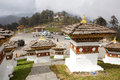 Chortens at the dochula pass bhutan memorial or stupas known as druk wangyal with a monastery in background Royalty Free Stock Image