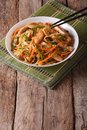 Chow mein with chicken and vegetables vertical on the table Royalty Free Stock Photography