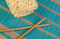 Chow mein noodles raw on a traditional bamboo mat Royalty Free Stock Images