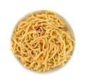 Chow mein noodles with shrimp in a small bowl top view of serving of and seasonings isolated on white background Royalty Free Stock Photo