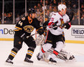 Chris neil and dennis seidenberg senators bruins defenseman try to locate the puck Royalty Free Stock Image