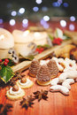 Chrismas beehive sweets with chrismas decoration christmas candle in background Stock Photo