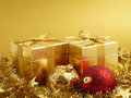 Chrismas gifts gold and ornaments with copy space Stock Photo
