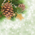Chrismas tree and pine cones on background with sparkles Royalty Free Stock Image