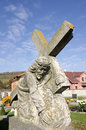 Christ carrying his cross the statue on tombstone rustic slovak cemetery Stock Images