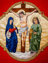 Christ on the cross adored by two maries Royalty Free Stock Images