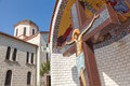 Christ on the cross in forecourt of church in greece Royalty Free Stock Photo