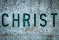 Christ in rock religious concept image of the word chiseled into wall Stock Image