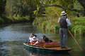 Christchurch new zealand march boatman guides group tourists their punt down avon river easter sunday afternoon Stock Photo