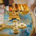 Christening in the church, golden religious utensils: bible, cross, prayer book, missal. Details in the orthodox christian church Royalty Free Stock Photo