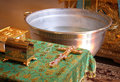 Christening holy bible orthodox cross and bowl prepared for ceremony in ukrainian church Stock Photos