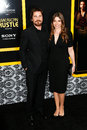 Christian bale sibi blazic new york dec actor and wife attend the american hustle premiere at the ziegfeld theatre on december in Royalty Free Stock Images