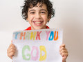 Christian child thanking god boy praying praising and thanking god religious kid over a white background young hispanic smiling Royalty Free Stock Photo