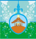 Christian christmas nativity scene of baby jesus in transparent ball hanging on blue background Royalty Free Stock Photography