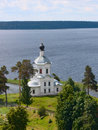 Christian church on the bank of lake Stock Photography