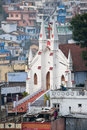 Christian church in coonoor tamil nadu india a view over town showing the and colourful painted houses the background Royalty Free Stock Images