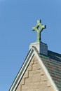 Christian cross decorative on roof of church Stock Photography