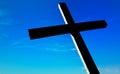 Christian cross over beautiful sunny sky Royalty Free Stock Photo