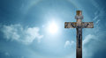 Christian cross over beautiful sunny sky panoramic view Royalty Free Stock Photo
