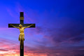 Christian cross over beautiful sunset background Royalty Free Stock Photo