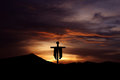 Christian cross over dark sunset background Royalty Free Stock Photo