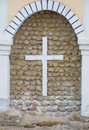 Christian cross over an old stone wall Royalty Free Stock Photo