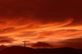 Christian cross over red sunset background landscape Royalty Free Stock Photo