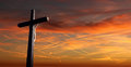 Christian cross over sunset background Royalty Free Stock Photo
