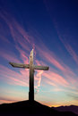 Christian cross over sunset background vertical image Royalty Free Stock Photo