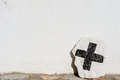 Christian cross painted on a whitewashed stone Royalty Free Stock Image