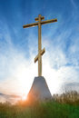 Christian cross sunrise at on blue sky background Stock Photo