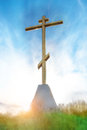 Christian cross sunrise at over blue cloudy sky Royalty Free Stock Images
