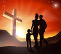 Christian family concept a walking towards a cross in a mountain landscape with sunrise over mountains lifestyle Stock Images