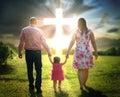 Christian family walks to cross Royalty Free Stock Photo