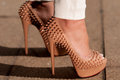 Christian louboutin mm lady peep spikes hristian worn by woman in white pants Stock Photo