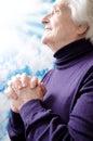 Christian religious senior woman praying Stock Photos