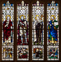 Christian saints stained glass window the peter george petroc and paul depicted in a Royalty Free Stock Image