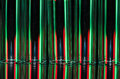 Christmas Abstract: Vertical Streaks of Red and Green Light Forming a Holiday Background Royalty Free Stock Photo