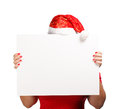 Christmas advertisement woman in new year or hat hiding behind the isolated on white background Royalty Free Stock Photos