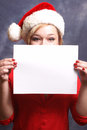 Christmas advertisment a festive woman holds up a sign for your message Royalty Free Stock Photos