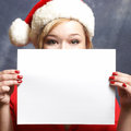 Christmas advertisment a festive woman holds up a sign for your message Stock Photos