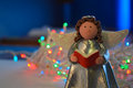Christmas angel with book and garland Royalty Free Stock Images