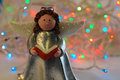 Christmas angel with book and garland Stock Photos