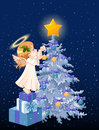 Christmas angel decorating tree Stock Images