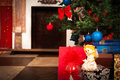 Christmas angel with a fireplace on background Royalty Free Stock Photo