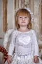 Christmas angel girl in white clothes Stock Photos